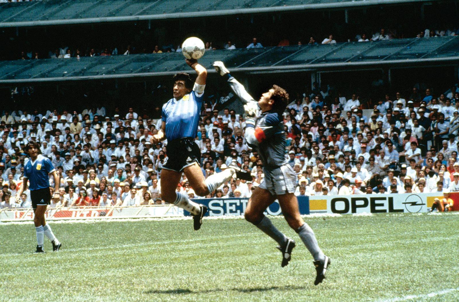 Diego Maradona of Argentina scoring his 'hand of God' goal past Peter Shilton of England in the World Cup quarter-finals, Mexico City, June 1986
