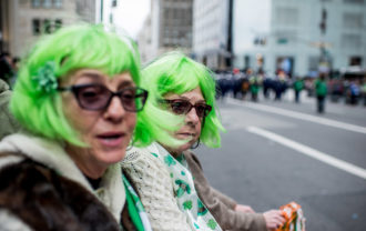 Spectators watching the St. Patrick's Day Parade, New York City, March 17, 2016
