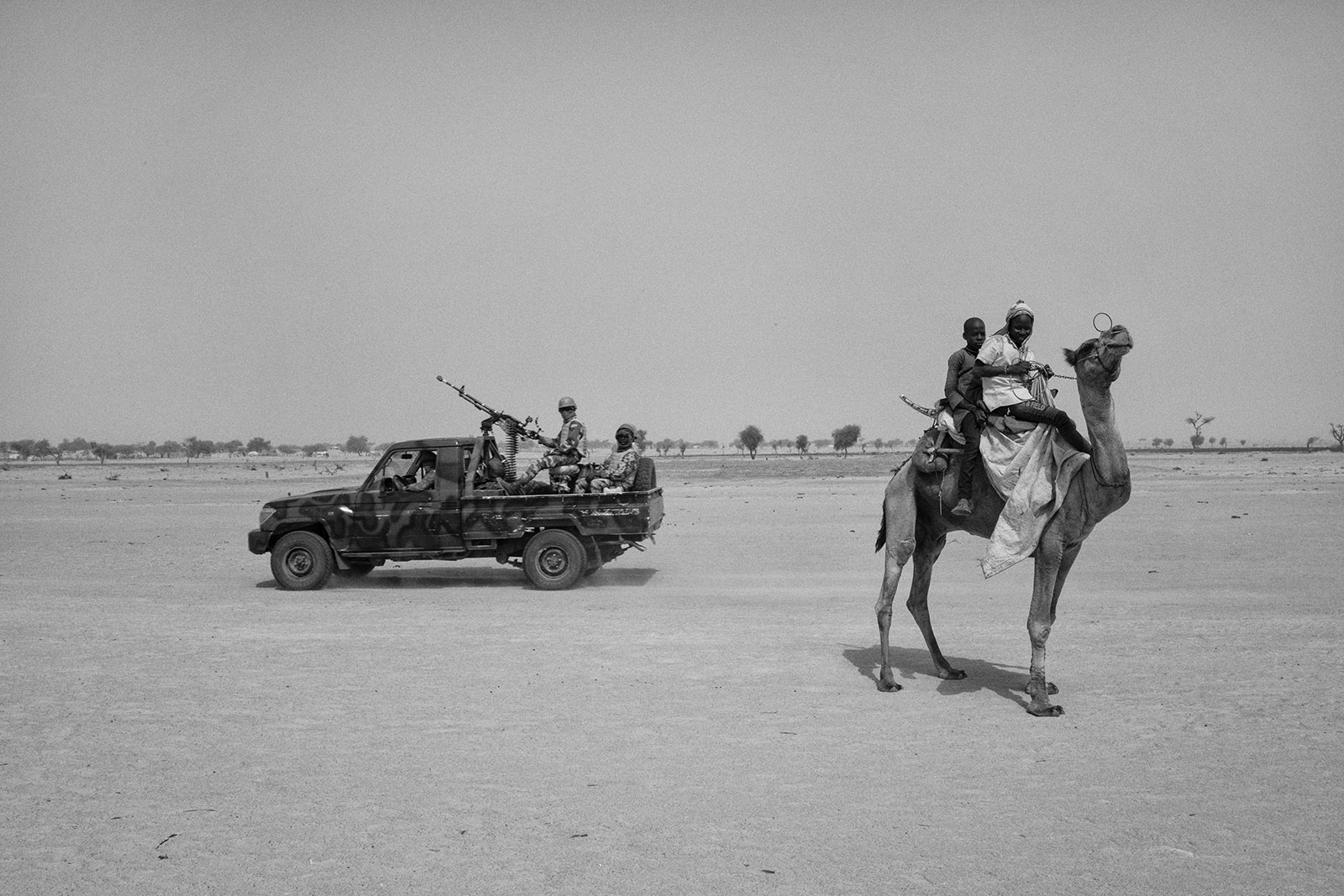 Security forces passing near a refugee camp for Nigeriens displaced by Boko Haram attacks, Niger, 2017