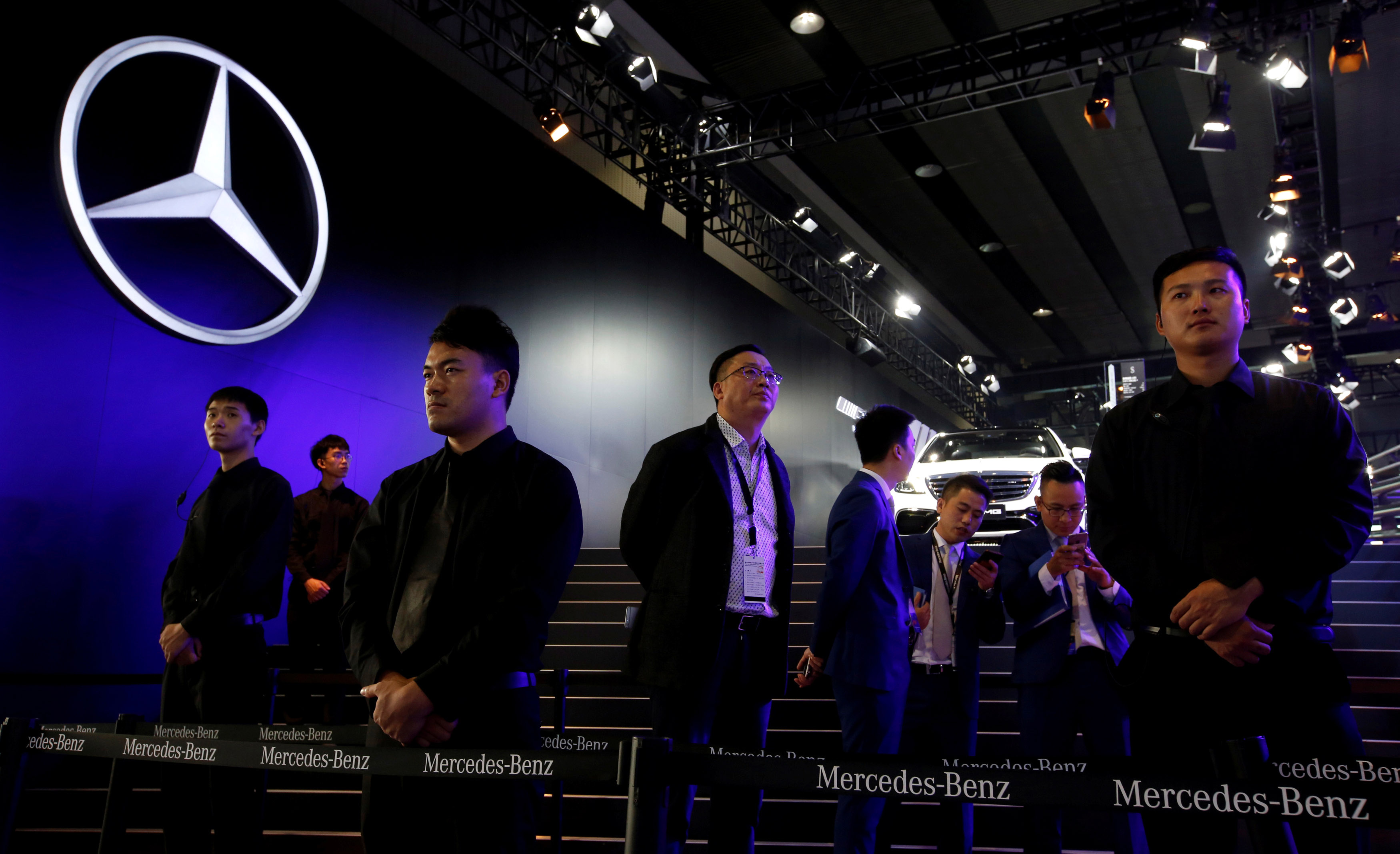 Security staff guarding the Mercedes-Benz booth at an autoshow in Guangzhou, China, in November 2017