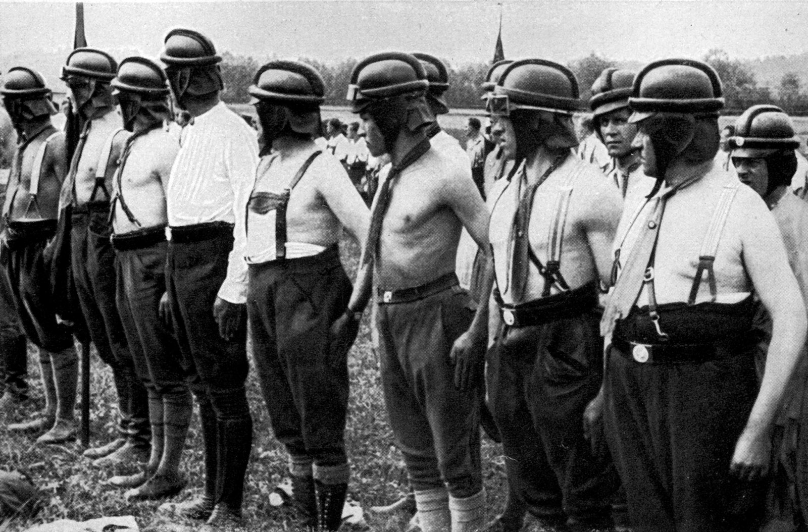 """Stormtroopers without their brown uniforms, which were banned by German authorities several times between their introduction in 1926 and Hitler's appointment as chancellor in 1933. Daniel Siemens writes that an 'SA troop...with members dressed in white shirts or other surrogate """"uniforms"""" still remained highly recognizable.'"""