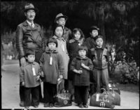 'Members of the Mochida family awaiting evacuation bus,' Hayward, California, May 1942; photograph by Dorothea Lange. It is on view in the exhibition 'Then They Came for Me: Incarceration of Japanese Americans During World War II,' at the International Center of Photography, New York City, January 26–May 6, 2018.