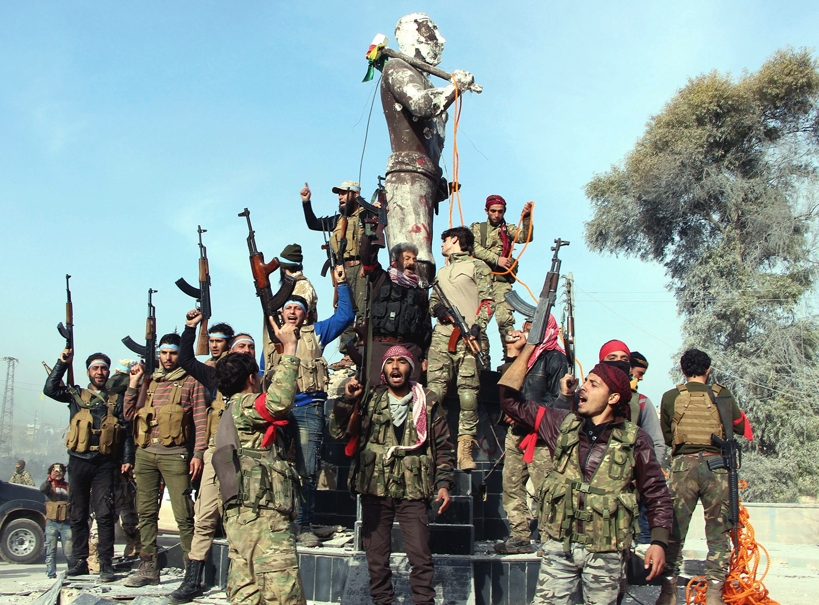 Turkish-backed Syrian National Army fighters preparing to destroy a statue of Kaveh, a heroic figure in Kurdish mythology, in Afrin, Syria, March 18, 2018