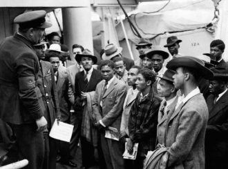 RAF officials from the Colonial Office welcoming Jamaican immigrants disembarked from the Empire Windrush at Tilbury docks, June 22, 1948