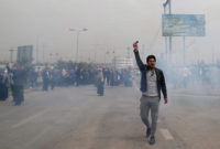Teargas filling the air as Kurdish government police tried to disperse a protest of civil servants in Erbil, Iraq, March 25, 2018