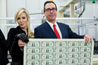 Treasury Secretary Steven Mnuchin and his wife, Louise Linton, holding an uncut sheet of one-dollar bills bearing Mnuchin's name, Washington, D.C., November 2017