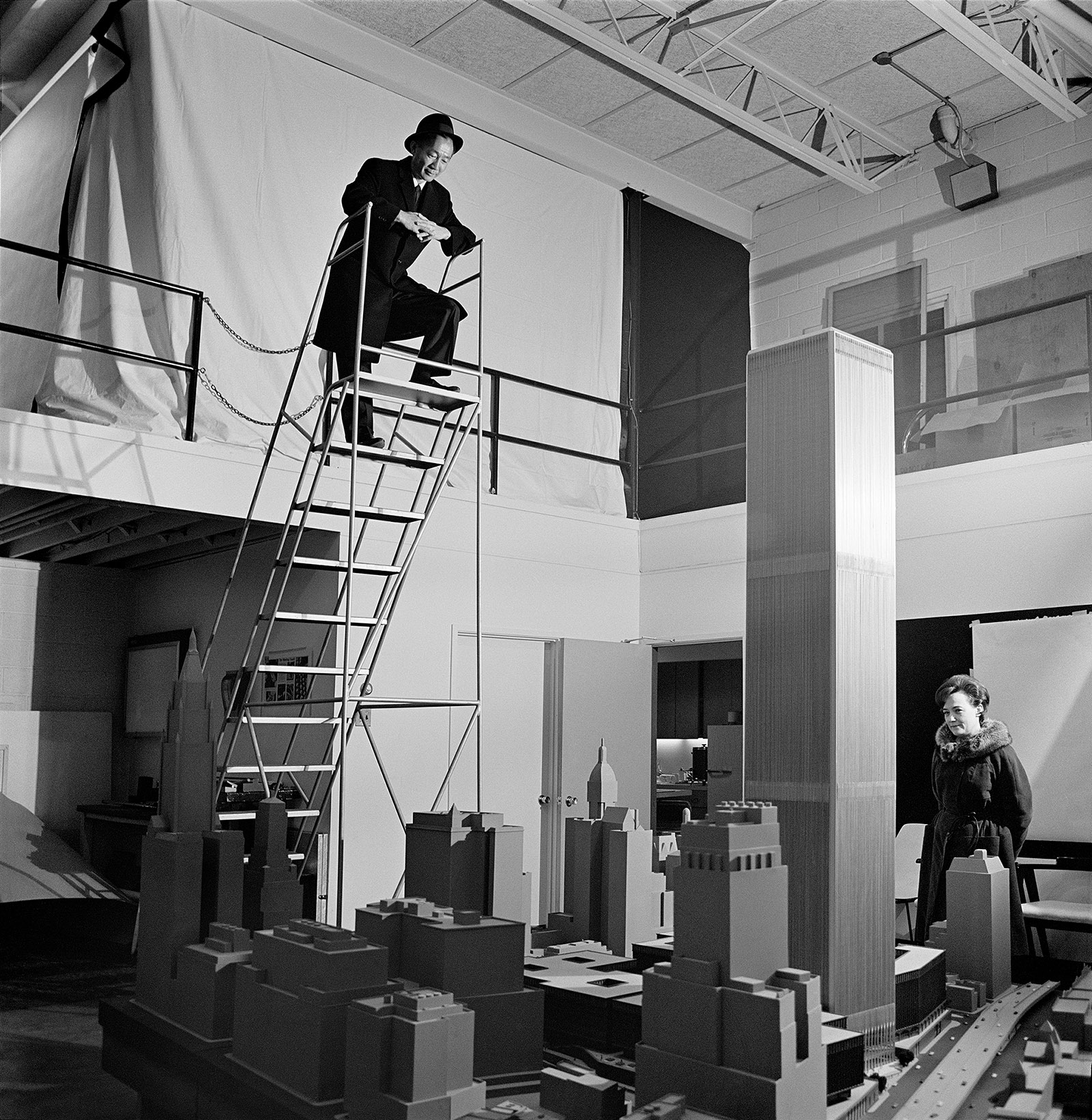 Minoru Yamasaki and his assistant reviewing his model for the World Trade Center, circa 1970