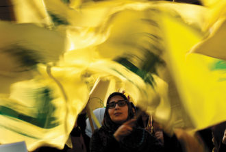 A Hezbollah supporter during a campaign speech by Hezbollah secretary-general Hassan Nasrallah near Beirut, Lebanon, April 2018