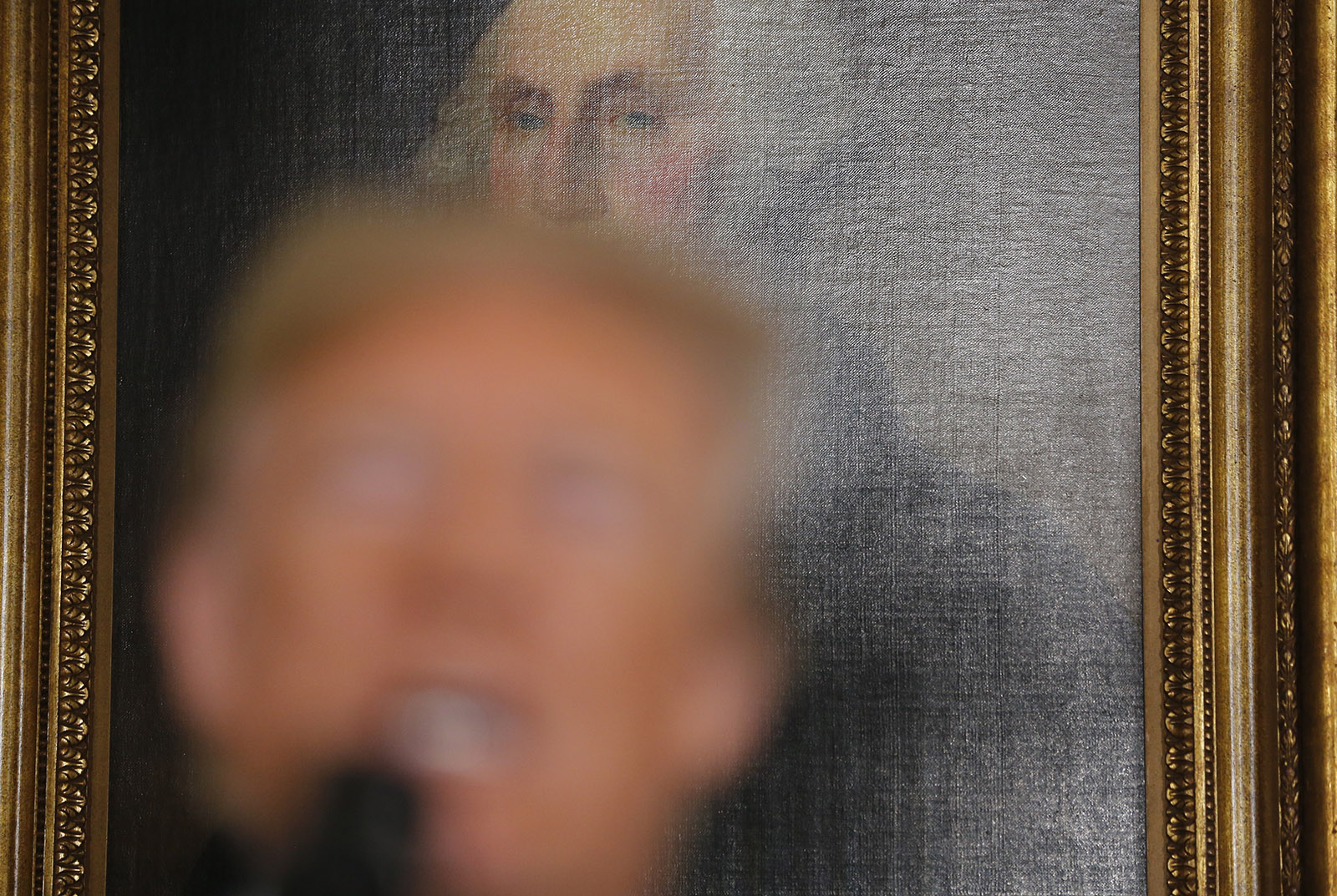 President Trump announcing the US's withdrawal from the Iran nuclear agreement in front of a portrait of George Washington in the White House, May 8, 2018