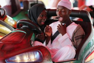 Visitors at an amusement park in London during an Eid celebration, July 2014