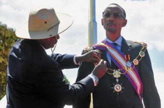 Rwandan president Paul Kagame receiving the Pearl of Africa Medal from Ugandan president Yoweri Museveni, Kapchorwa District, Uganda, 2012