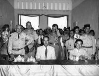 Edward Lansdale (second row, hand on hat) standing behind Lieutenant General John W. 'Iron Mike' O'Daniel, commander of the US Military Assistance Advisory Group (left), Ambassador G. Frederick Reinhardt (center), and Ngo Dinh Diem (right), Saigon, 1955