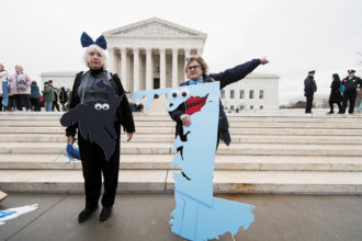 Anti-gerrymandering activists in costume as Maryland district 5 (left) and district 1 (right) in front of the Supreme Court, March 2018
