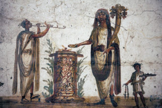 A fresco showing lares, or local household gods, from a shrine in Pompeii, circa first century AD