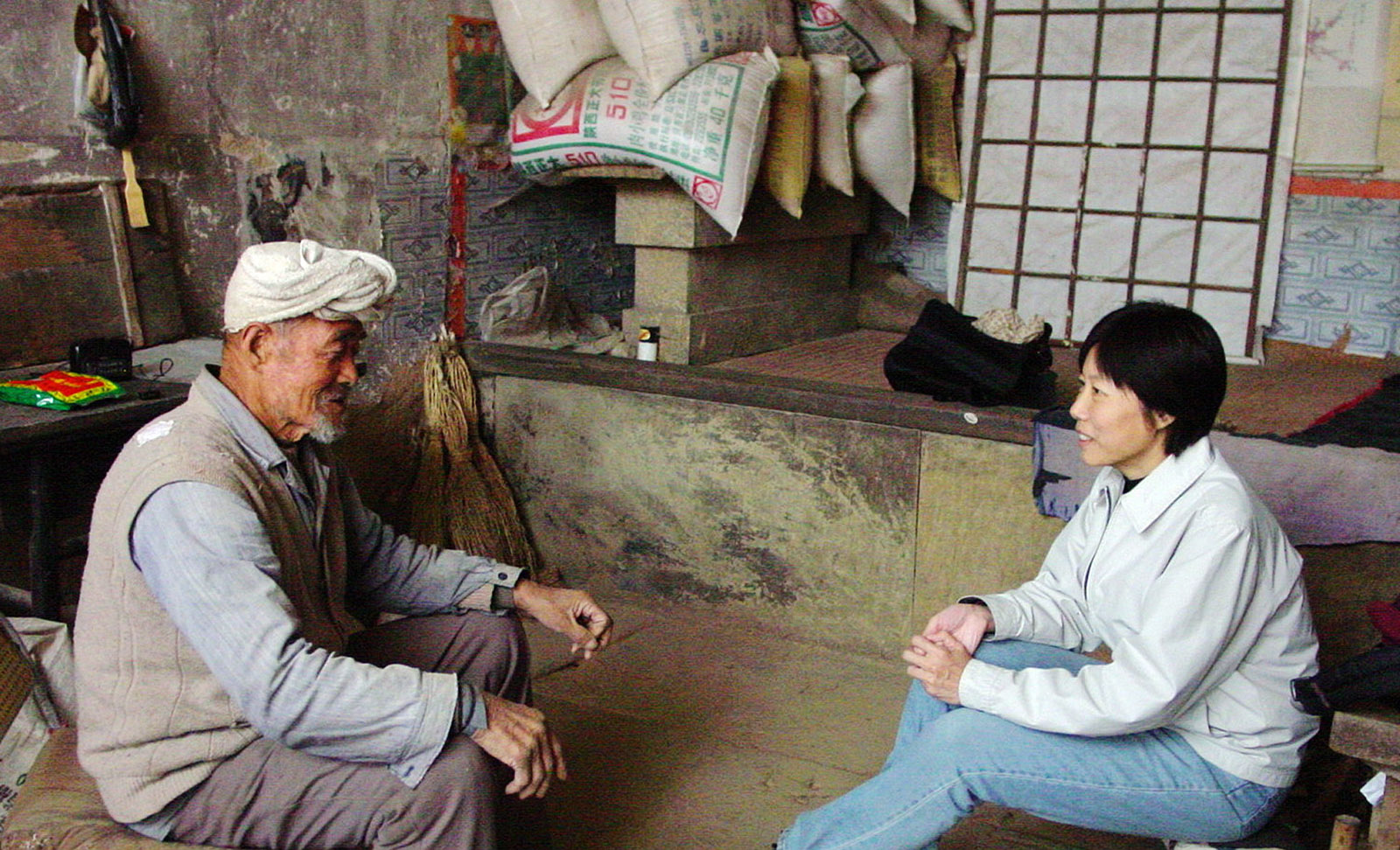 Guo Yuhua with a villager in Ji, northern Shanxi, China, 2005