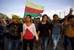 Kurdish women of the Kobani canton in Rojava marching in a demonstration calling for the release of the PKK leader Abdullah Öcalan, Syria, 2015