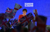 Party leader Arlene Foster addressing the November 2017 conference of the Democratic Unionist Party as delegates waved Union and Ulster flags, Belfast, Northern Ireland