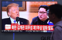 A railway station TV screen showing US President Donald Trump and North Korean leader Kim Jong-un, Seoul, South Korea, May 16, 2018