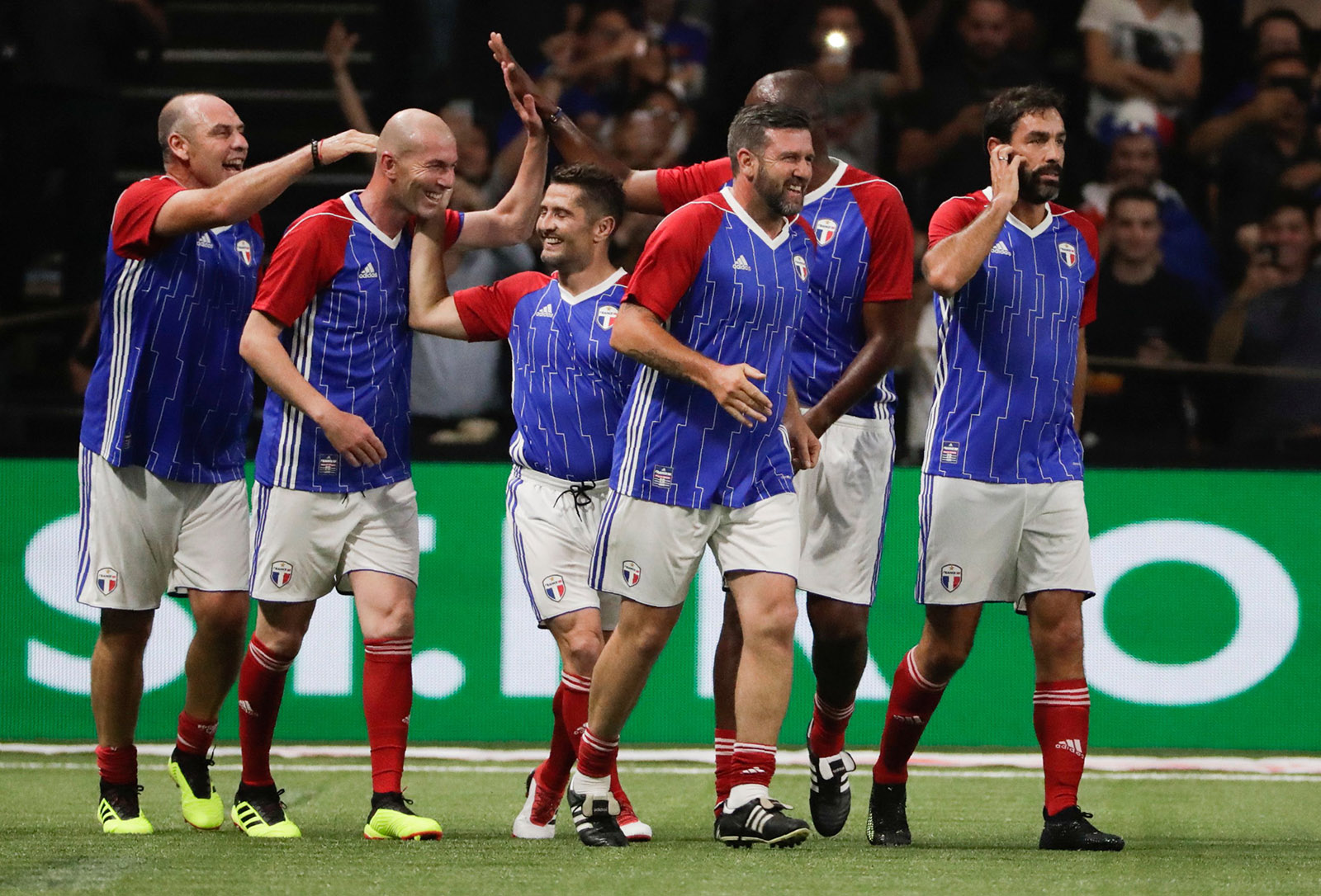 Players celebrating after Zinedine Zidane (second left) scored in an exhibition match featuring veterans from France's 1998 World Cup-winning team, Nanterre, France, June 12, 2018