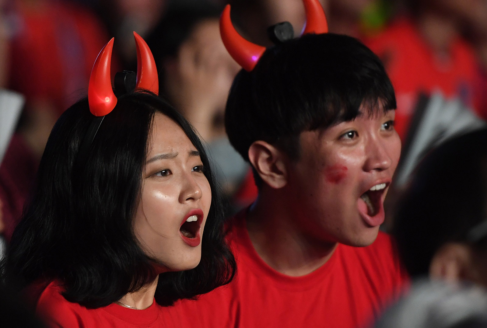 Fans watching the match between South Korea and Sweden on a large screen, Seoul, June 18, 2018
