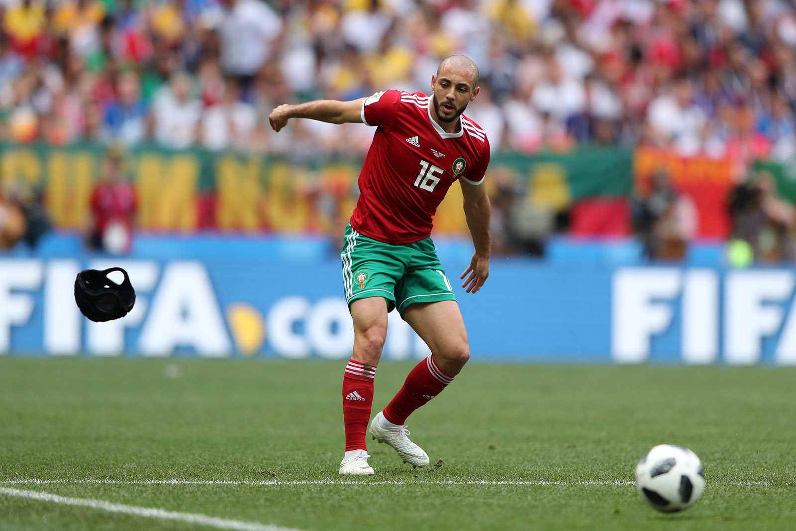 Noureddine Amrabat throwing aside his protective headgear during Morocco's match against Portugal at the Luzhniki Stadium, Moscow, Russia, June 20, 2018