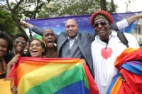 Activist Jason Jones celebrating with others after Trinidad and Tobago's High Court ruled against the country's anti-homosexual laws, outside the Hall of Justice, Port-of-Spain, Trinidad and Tobago, April 12, 2018