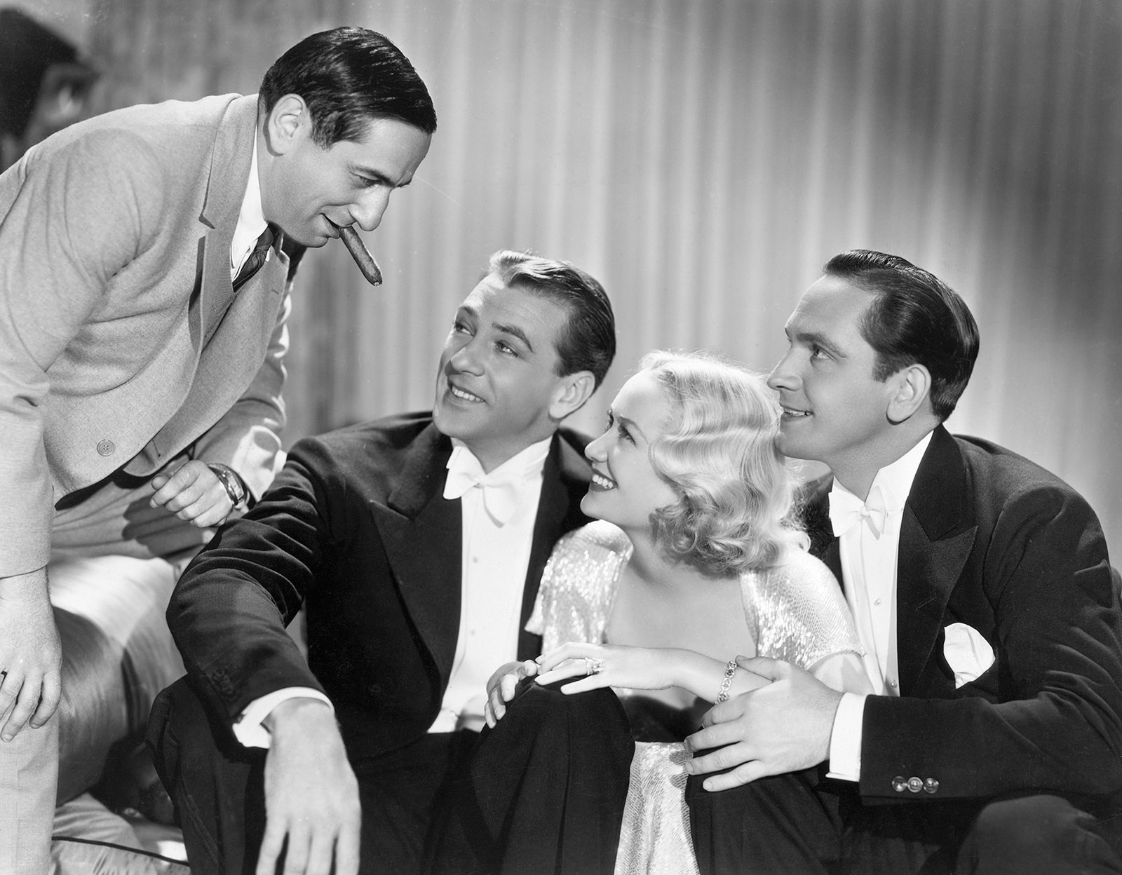 Ernst Lubitsch, Gary Cooper, Miriam Hopkins, and Fredric March on the set of Design for Living, 1933