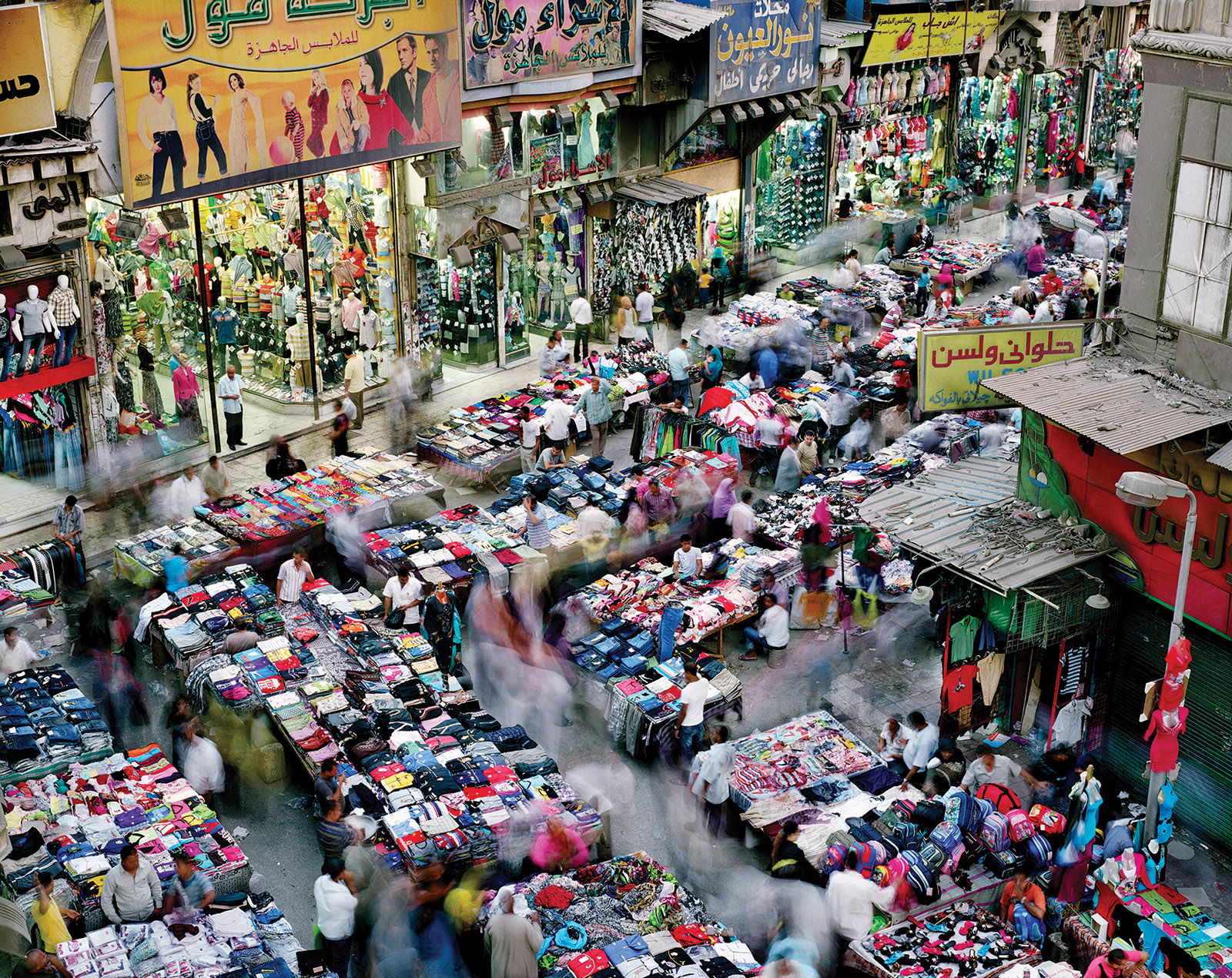 A clothing market in Cairo, 2011; photograph by Martin Roemers from his book Metropoli, published by Hatje Cantz in 2015