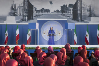 MEK leader Maryam Rajavi presiding over a rally in memory of the group's members killed in Iraq in 2013, Tirana, Albania, September 1, 2017