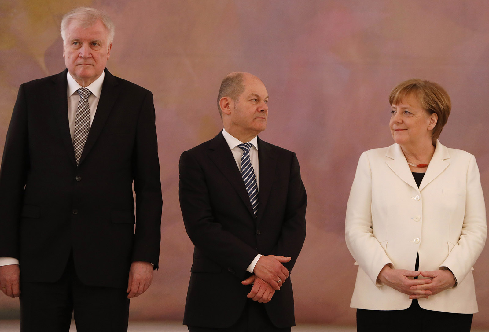 Interior Minister Horst Seehofer and Chancellor Angela Merkel flanking Vice Chancellor Olaf Scholz at the formation of Germany's new coalition government, Berlin, March 14, 2018