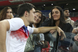England player Harry Maguire talking to his fiancée Fern Hawkins after the game against Colombia at Spartak Stadium, Moscow, Russia, July 3, 2018