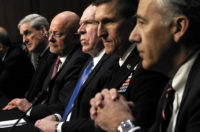 Robert Mueller, James Clapper, John Brennan, Michael Flynn, and Philip Goldberg at a Senate Intelligence Committee hearing, Washington, D.C., March 2013