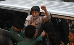 Photojournalist Shahidul Alam arriving for a court appearance following his arrest after a student protest, Dhaka, August 6, 2018
