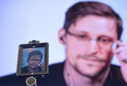 Former NSA contractor Edward Snowden delivering a speech by video-link from Russia to a conference in Lisbon, Portugal, May 30, 2017