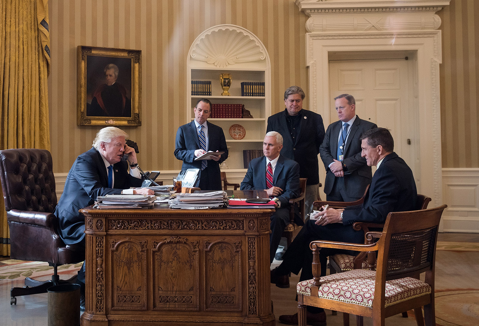 President Donald Trump speaking on the phone with Russian President Vladimir Putin, with Chief of Staff Reince Priebus, Vice President Mike Pence, White House Chief Strategist Steve Bannon, Press Secretary Sean Spicer, and National Security Adviser Michael Flynn in attendance in the Oval Office, January 28, 2017