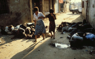 Surviving Palestinian civilians returning to the refugee camps of Sabra and Shatila after the massacre carried out by Phalange-linked militiamen, Beirut, Lebanon, September 21, 1982