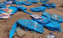 Blood-stained backpacks at the site of a Saudi airstrike that killed fifty-one people, including forty children, Saada, Yemen, August 10, 2018