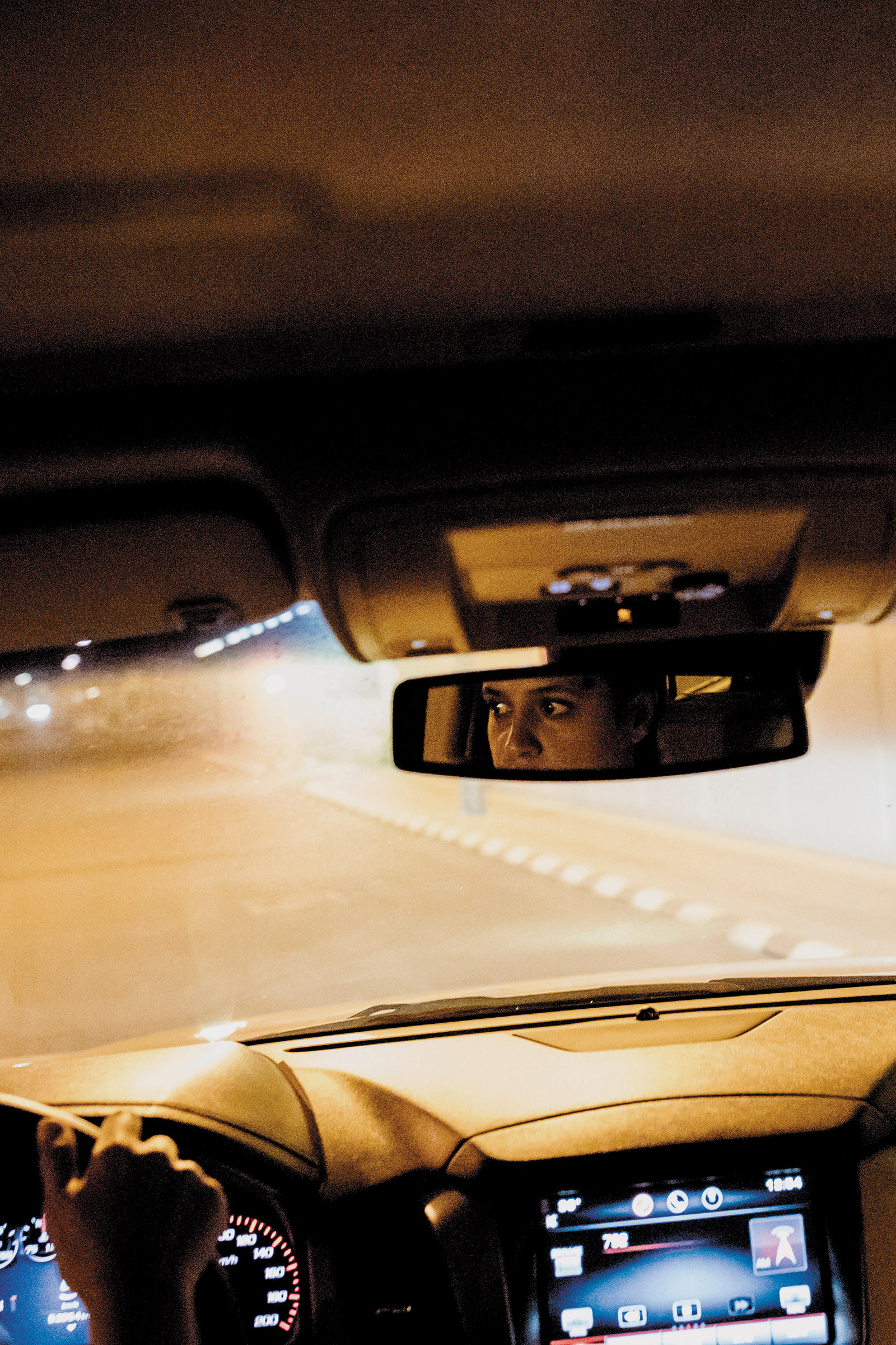 A woman practicing driving in preparation for the end of the ban on female drivers, Jeddah, Saudi Arabia, June 2018; photograph by Iman al-Dabbagh