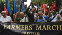 Yogendra Yadav, co-founder of the Swaraj Abhiyan party, activist Medha Patkar, and various members of farmer unions protesting in New Delhi, July 20, 2018