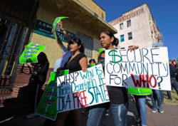Protesters from an immigrant rights group marching to protest the Secure Communities program, Los Angeles, California, August 2011
