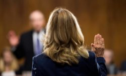 Dr. Christine Blasey Ford being sworn in before testifying during a Senate Judiciary Committee hearing regarding Brett Kavanaugh's Supreme Court nomination, Capitol Hill, Washington, D.C., September 27, 2018