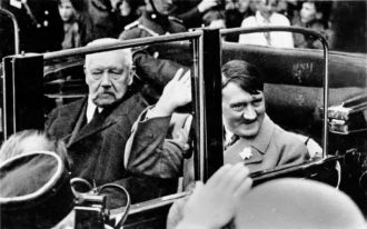 German President Paul von Hindenburg and Chancellor Adolf Hitler on their way to a youth rally at the Lustgarten, Berlin, May 1933