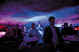 Daoist practitioners meditating in a cave in Jinhua, Zhejiang province, China, 2011