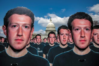 Cardboard cutouts of Mark Zuckerberg placed outside the Capitol to protest the spread of disinformation on Facebook, Washington, D.C., April 2018