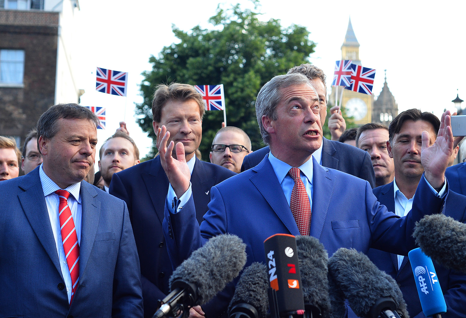 Nigel Farage speaking at a press conference the day after the Brexit referendum, flanked by Arron Banks (far left) and Andy Wigmore (right), Westminster, London, June 24, 2016