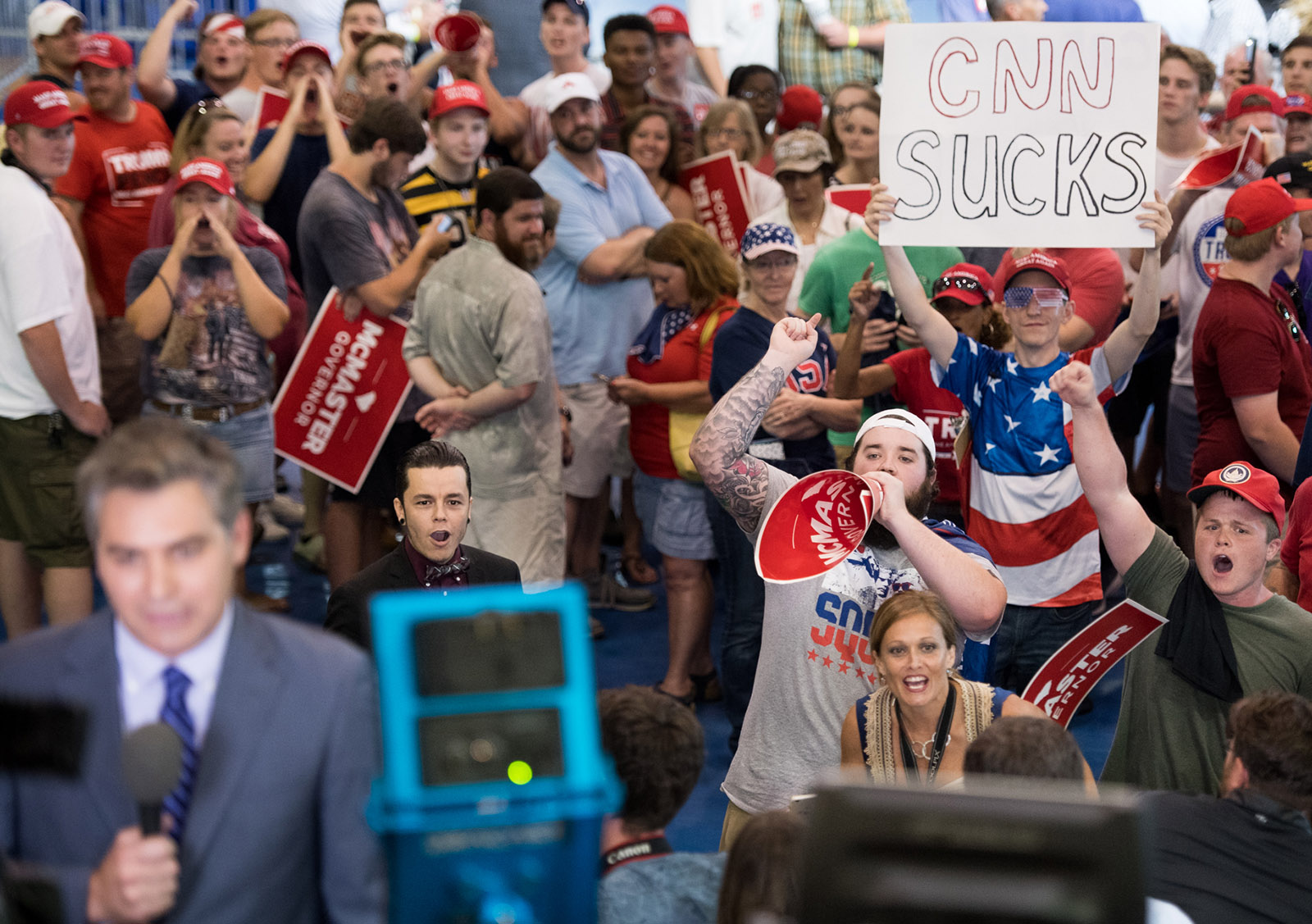 People shouting behind CNN reporter Jim Acosta before a Trump rally, West Columbia, South Carolina, June 25, 2018