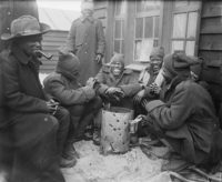 South African Native Labour Corps troops around a brazier at their camp in Dannes, France, March 1917