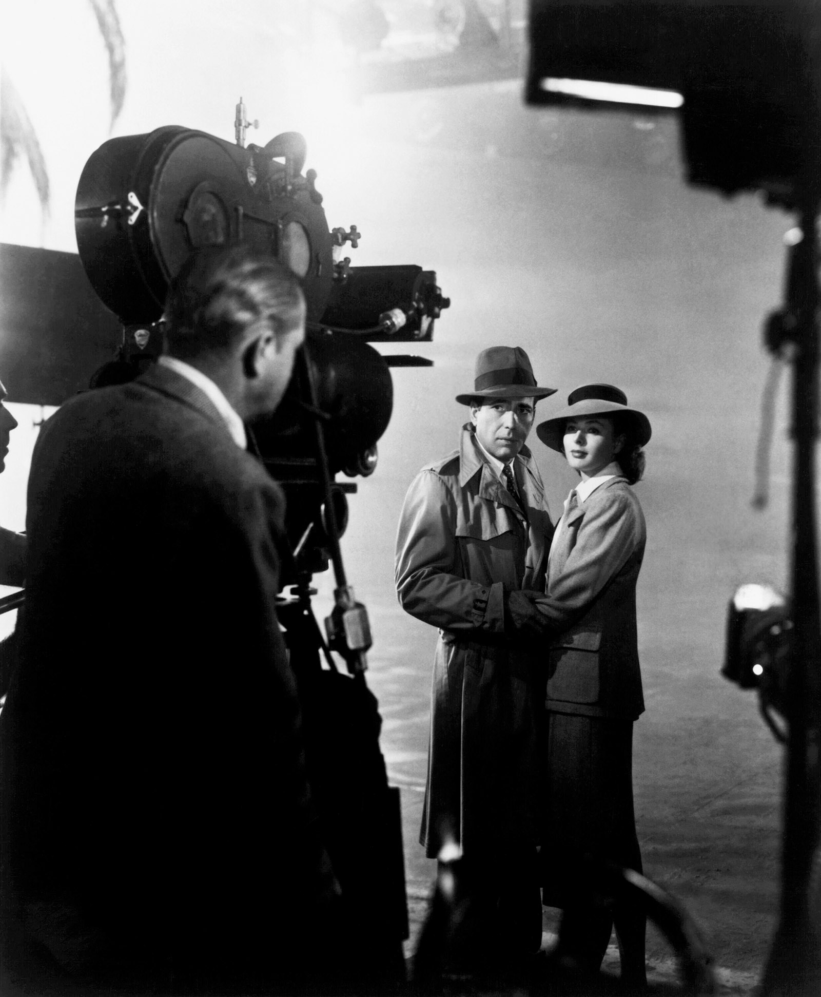 Michael Curtiz directing Humphrey Bogart and Ingrid Bergman on the set of Casablanca, 1942