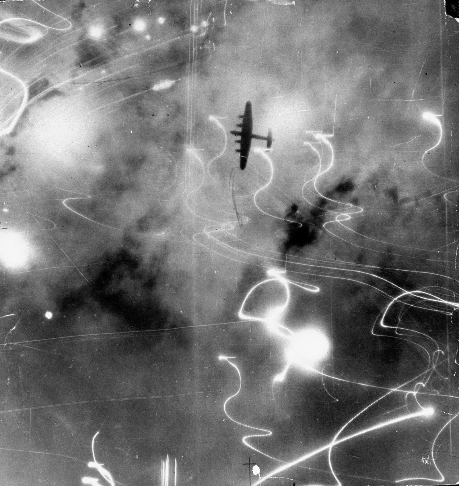 A Royal Air Force Lancaster bomber during a night raid over Hamburg, Germany, 1943