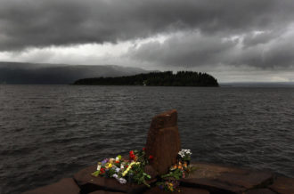 Flowers laid near Utoya Island after Anders Behring Breivik's mass-murder attack, Norway, July 24, 2011